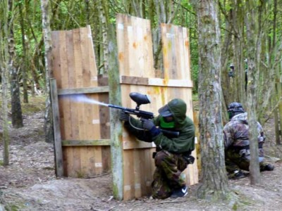 green paintballer aiming at base