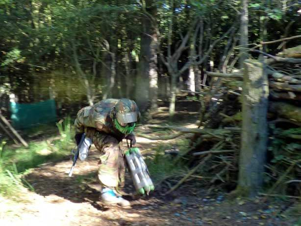 green paintball player running with bomb