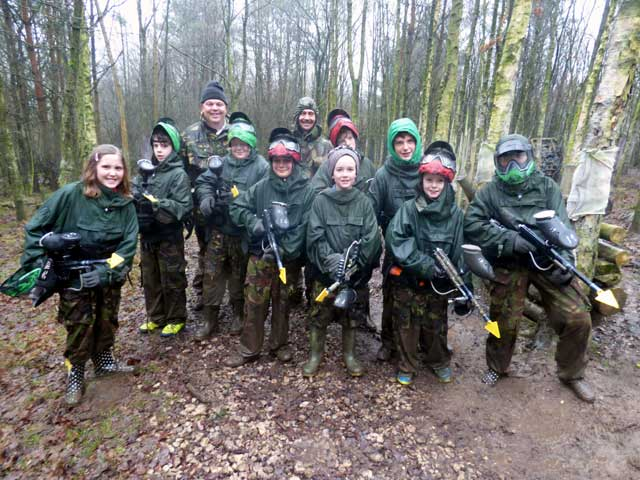 girls and boys paintballing